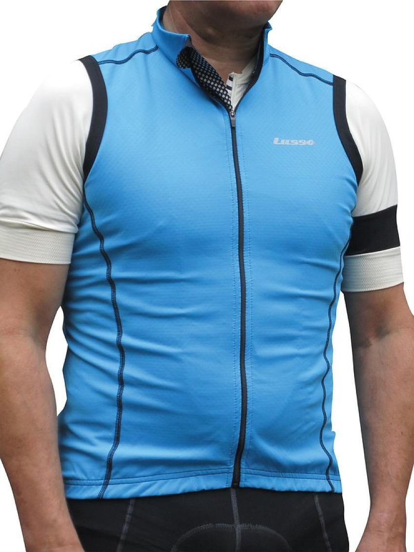 A man wears an aqua blue gilet