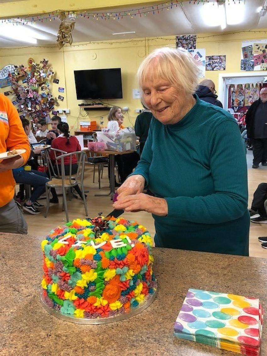 Sylvia cutting into her birthday cake